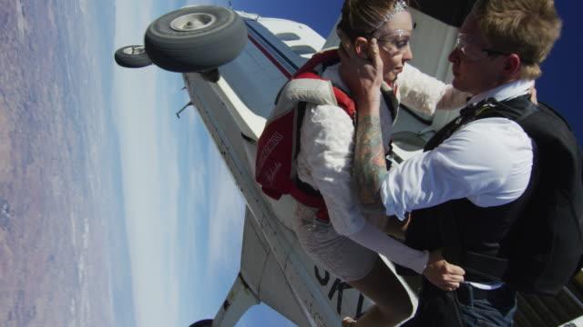 Elegant Skydiving Couple Exits Airplane