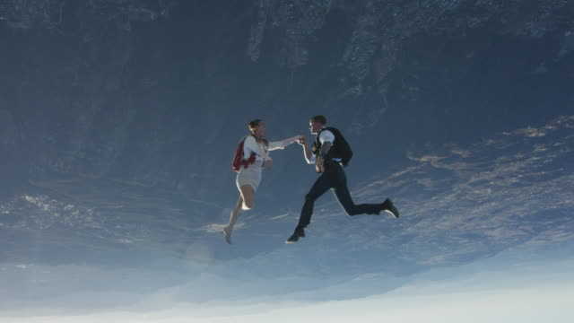 elegant skydiving couple kisses hand - flying stock videos & royalty-free footage