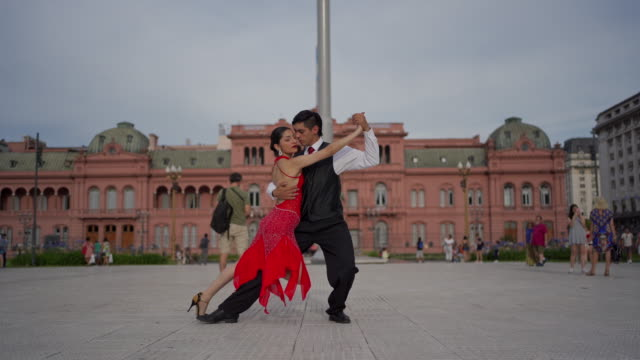 elegant tango dancing couple performing outdoors - tango dance stock videos & royalty-free footage