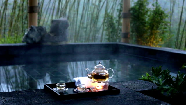 elegant tea set near spa pool outdoors