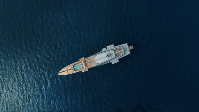 elegant white yacht in the mediterranean sea, nissi beach, ayia napa, cyprus. aerial drone shot. - yacht stock videos & royalty-free footage