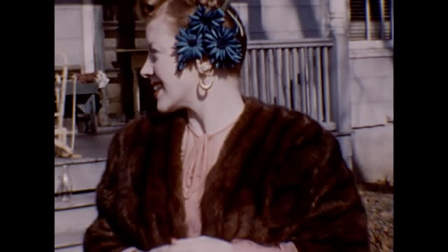 1953 elegant woman in furs showing off jewelry - orecchini video stock e b–roll