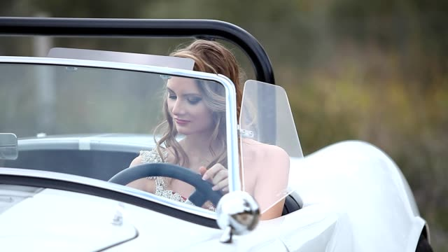 elegant woman in vintage car - collector's car stock videos and b-roll footage