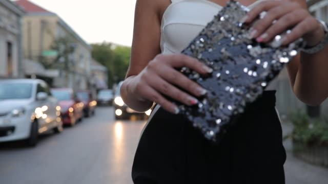 elegant woman walking in city - purse stock videos & royalty-free footage
