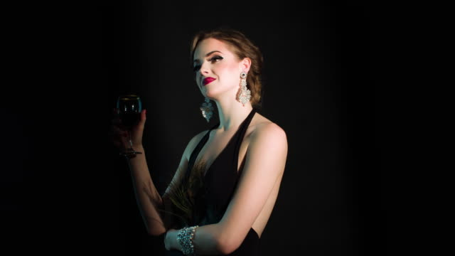 Elegant woman with a glass of wine