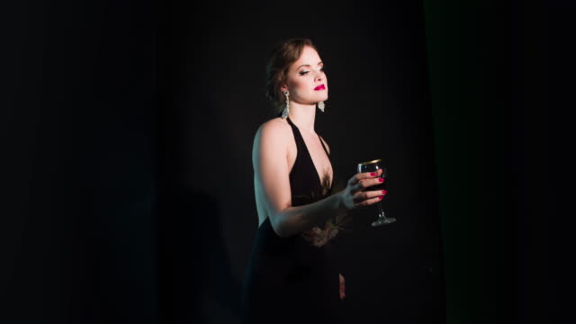 elegant woman with a glass of wine - glamour stock videos & royalty-free footage