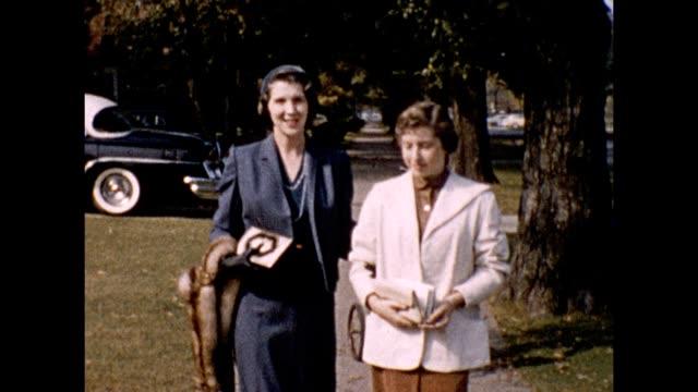 1957 Elegantly Dressed Women on Sidewalk