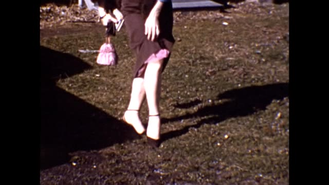 1953 elegantly-dressed woman flirting - dessous stock-videos und b-roll-filmmaterial
