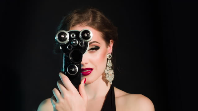 elegants woman with old movie camera - stage make up stock videos and b-roll footage