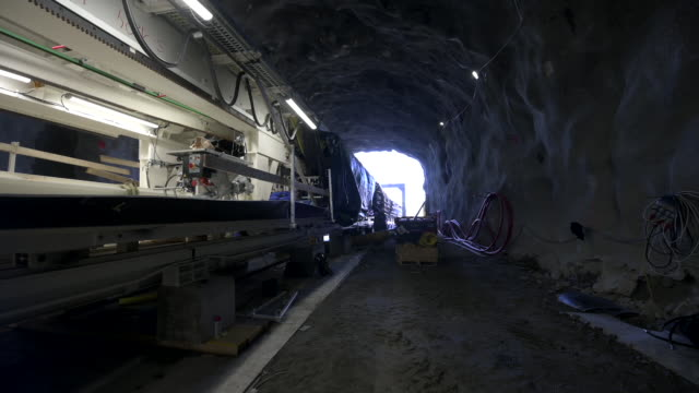 elektra 240meter long specially built boring machine will pierce through granite and gneiss just outside stockholm to build tunnel for new power... - mineral stock videos & royalty-free footage