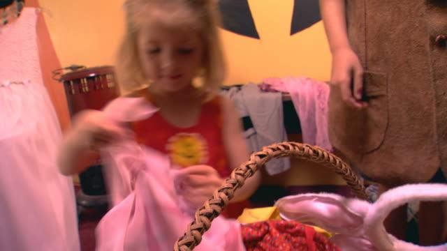 Elementary age girl playing dress up (handheld shot)