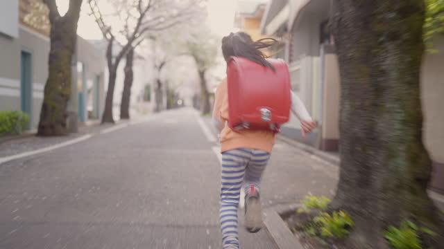 elementary age girl walking back to her mother - first day of school stock videos & royalty-free footage