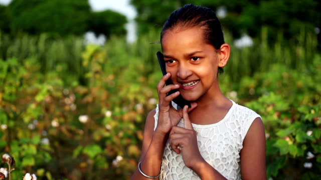 elementary age school child talking on smartphone, - petite teen girl stock videos and b-roll footage