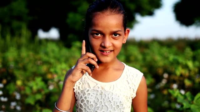 Elementary age school child talking on smartphone,