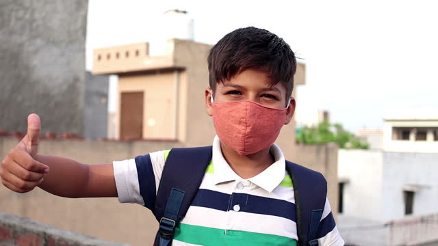 elementary age schoolboy covering his face with pollution mask for protection from viruses - 8 9 years stock videos & royalty-free footage