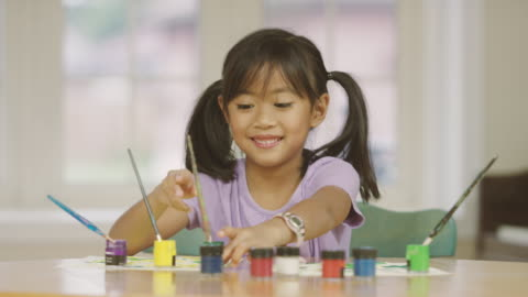elementary aged girl doing arts and crafts while homeschooling - art and craft stock videos & royalty-free footage