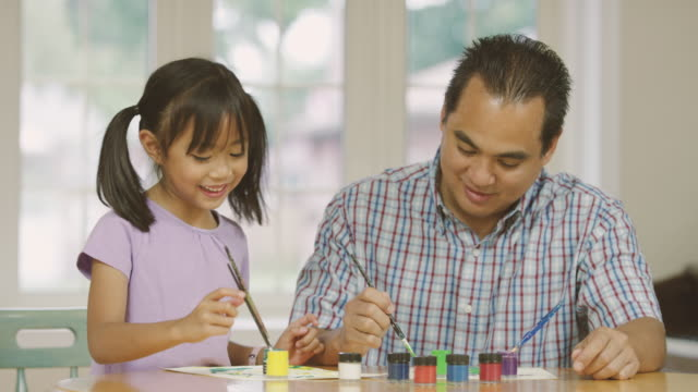 elementary aged girl doing arts and crafts with her father homeschooling - filipino ethnicity stock videos & royalty-free footage