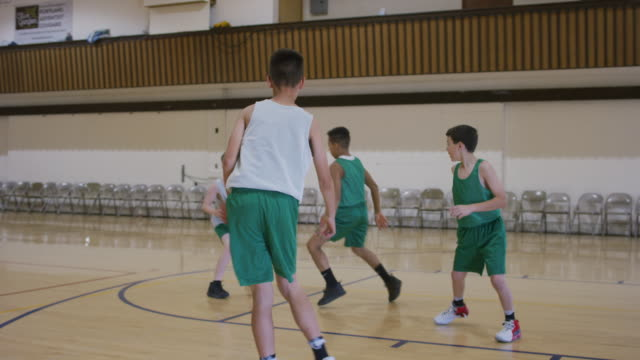elementary boys playing basketball - basketball sport stock videos & royalty-free footage