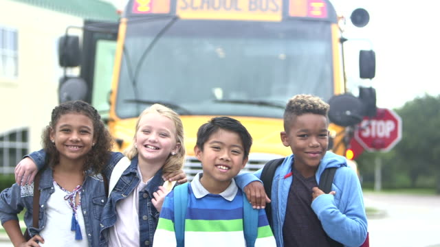 elementary children standing in front of school bus - 8 9 years stock videos & royalty-free footage