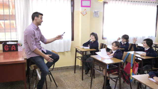 elementary education in latin america - pupils writing in theirs notebooks in classroom - school uniform stock videos & royalty-free footage