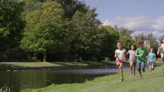 elementary friends running by the water - ontario canada stock videos and b-roll footage