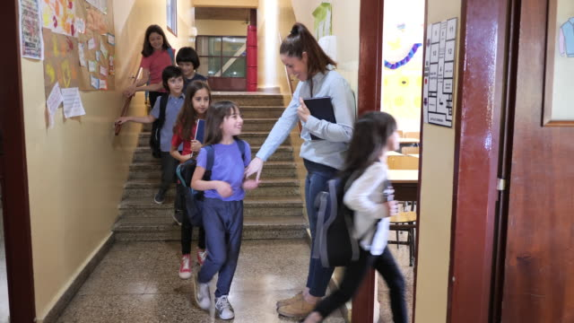 elementary school - back to school - education in latin america with female teacher, kids entering the classroom - professor stock videos & royalty-free footage