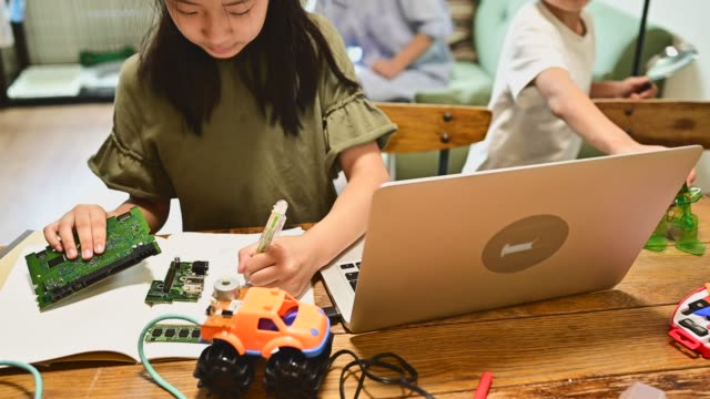elementary school boys and girls working on coding and robotics - stem topic stock videos & royalty-free footage