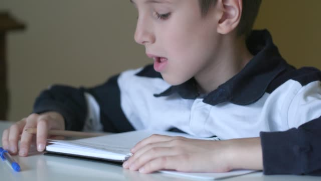 elementary school child disappointed having trouble with homework - head banging stock videos & royalty-free footage