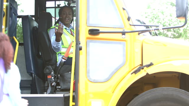 elementary school children board a school bus - moving toward stock videos & royalty-free footage
