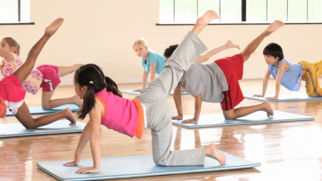 ms pan elementary school children in gym / richmond, virginia, united states     - yoga stock videos & royalty-free footage