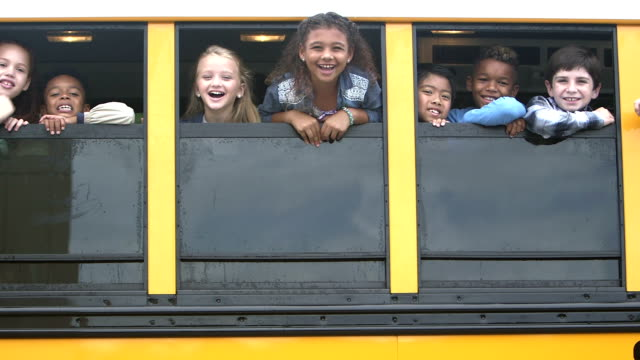 elementary school children looking out bus windows - education stock videos & royalty-free footage