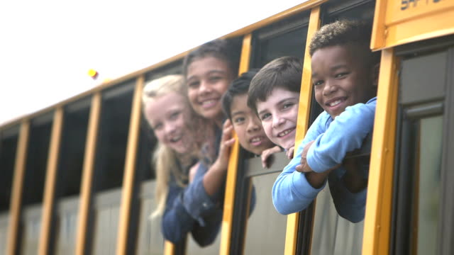 elementary school children looking out bus windows - kids in a row stock videos & royalty-free footage