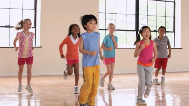 WS PAN Elementary School children running in gym / Richmond, Virginia, United States