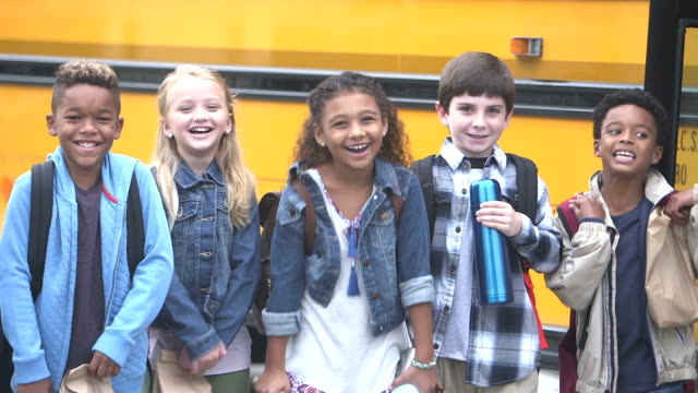 elementary school children waiting outside bus - packed lunch stock videos and b-roll footage