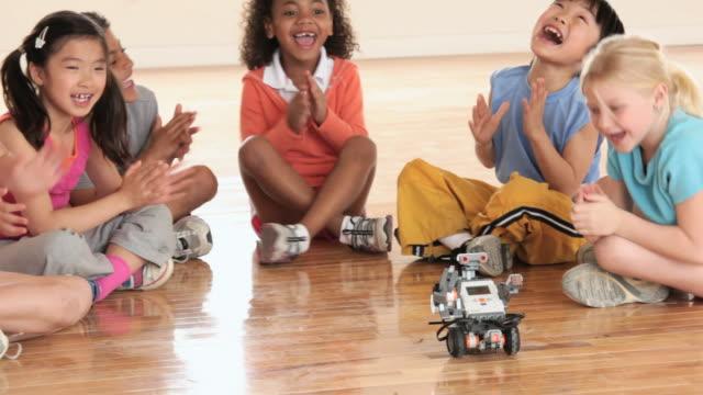 ms pan elementary school children with robot / richmond, virginia, united states     - spielzeug stock-videos und b-roll-filmmaterial