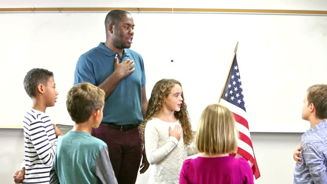 Elementary school class reciting pledge of allegiance
