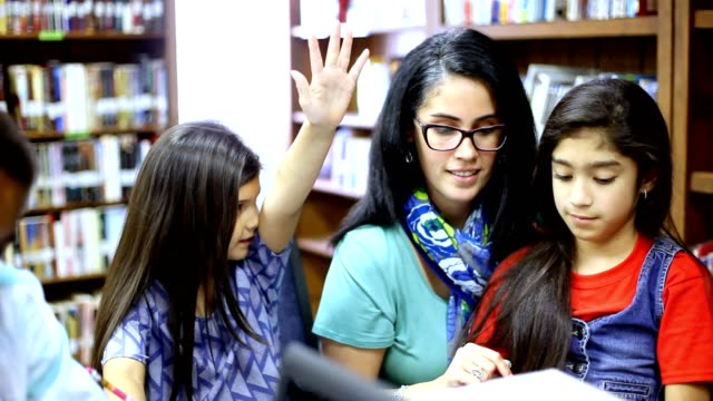 elementary school counselor with students in library. - guidance stock videos & royalty-free footage