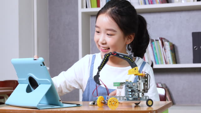 elementary school girl in smart education with educational toy - stem stock videos & royalty-free footage