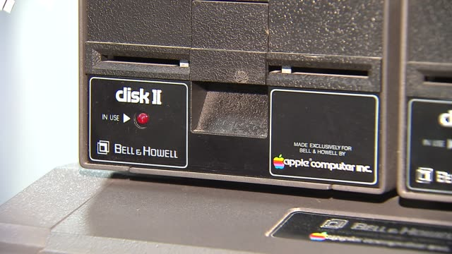 wgn elementary school hosts apple exhibit apple computers disk ii floppy disk subsystem on november 04 2013 in chicago illinois - disk stock videos and b-roll footage