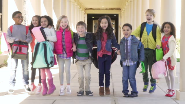 elementary school students in a line and jumping - multi ethnic group stock videos & royalty-free footage