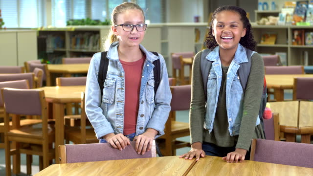 elementary school students in library - 10 11 years stock videos & royalty-free footage