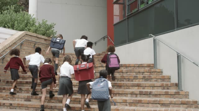 elementary school students moving up on steps - schoolboy stock videos & royalty-free footage