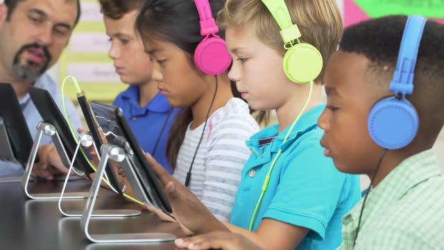 Elementary School Students working on Digital Tablets,