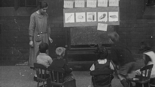 1925 montage elementary school teacher giving students flashcards and students placing their card against the appropriate picture on the board, and others working on arts and crafts / newcastle upon tyne, england, united kingdom - 1920 stock videos & royalty-free footage