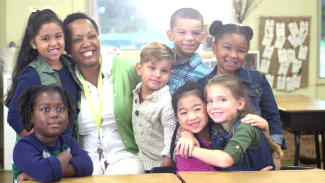 elementary school teacher with multi-ethnic children - 6 7 years stock videos & royalty-free footage