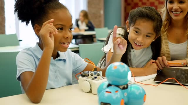 elementary stem students build robot in science class - stem topic stock videos & royalty-free footage