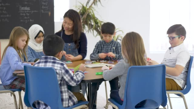 Elementary Students Doing Group Activity In Classroom