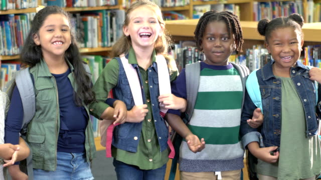 elementary students in school library - children only stock videos & royalty-free footage