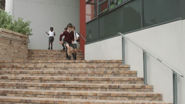elementary students leaving school building - school uniform stock videos & royalty-free footage