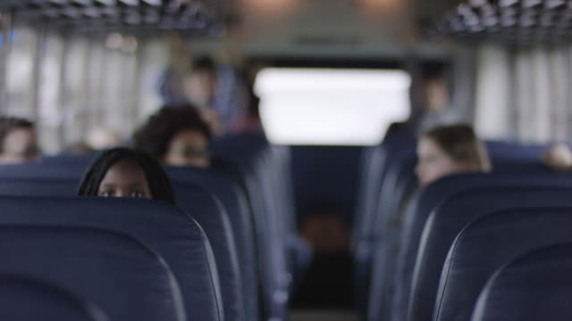 Elementary students sitting inside school bus